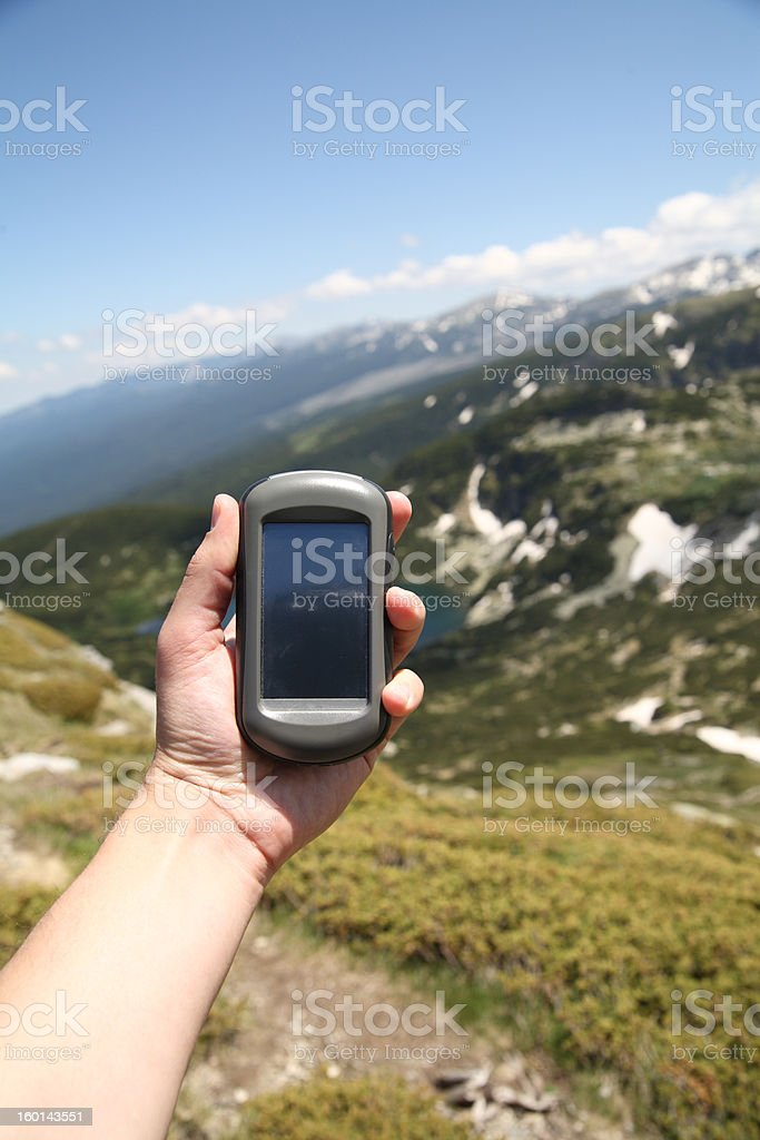 GPS navigator in hand royalty-free stock photo