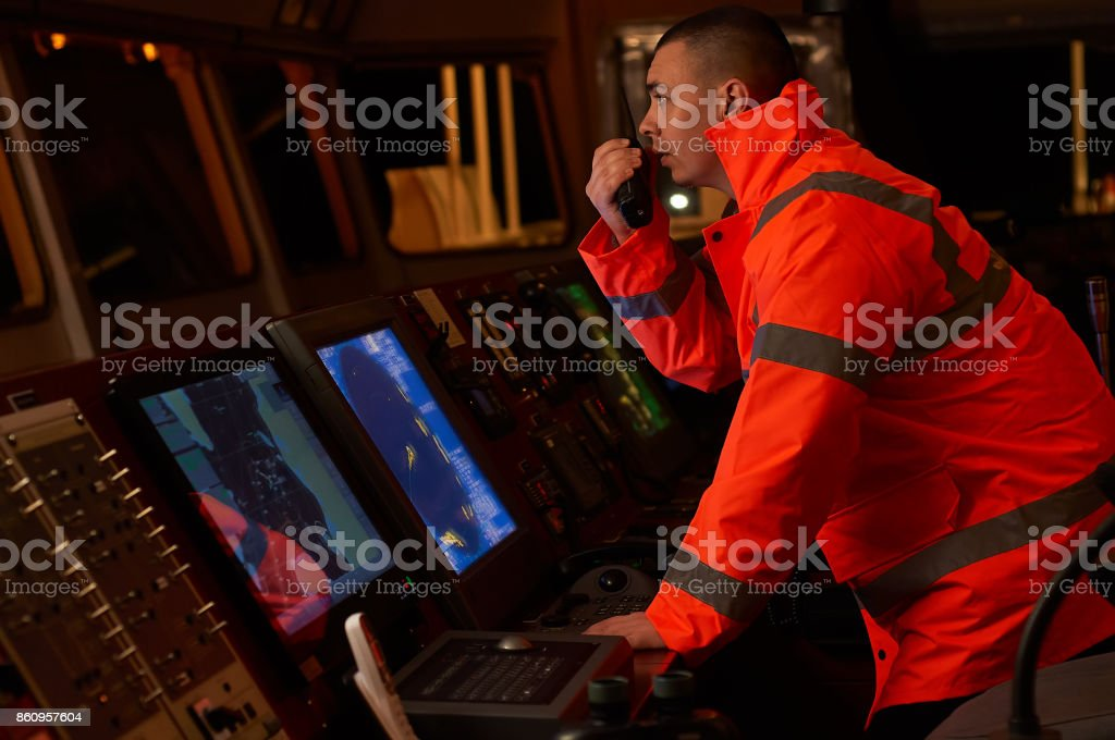 Navigator / Pilot on the bridge of the vessel stock photo