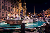 istock Navona square (Piazza Navona) at night.The famous square with the wonderful fountains and the historical buildings. 1133534826
