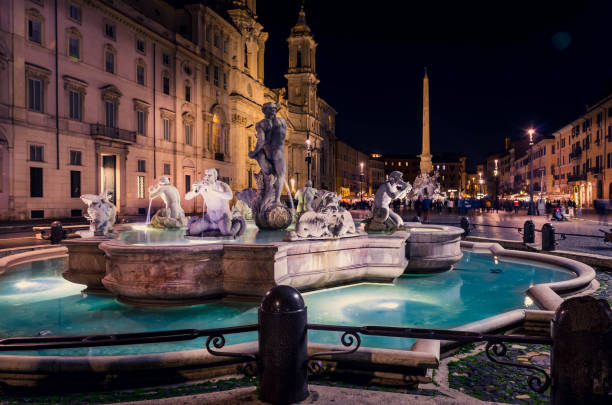 Navona square (Piazza Navona) at night.The famous square with the wonderful fountains and the historical buildings. stock photo