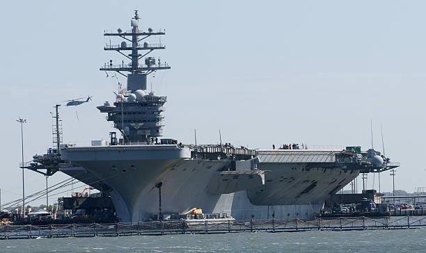 us navy aircraft carrier - flugzeugträger stock-fotos und bilder