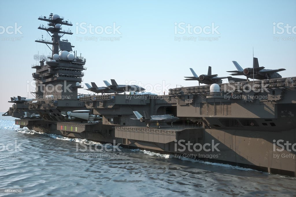 Navy aircraft carrier with a large compartment of aircraft and crew. stock photo