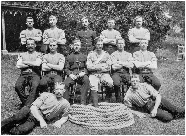 Navy and Army antique historical photographs: Tug of war team stock photo