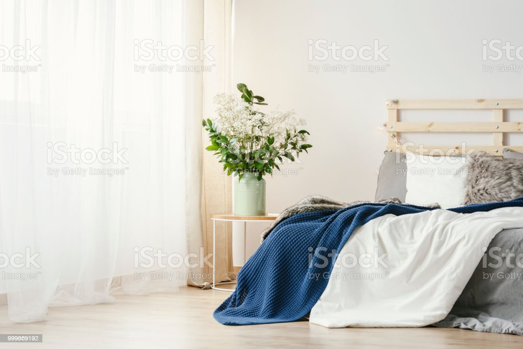Navy Blue Blanket Thrown On Double Bed With Lights On ...