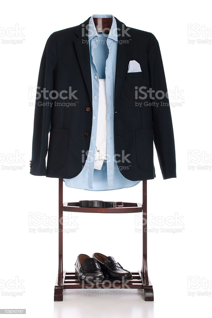 Navy blue blazer hanging over formal clothes tree royalty-free stock photo