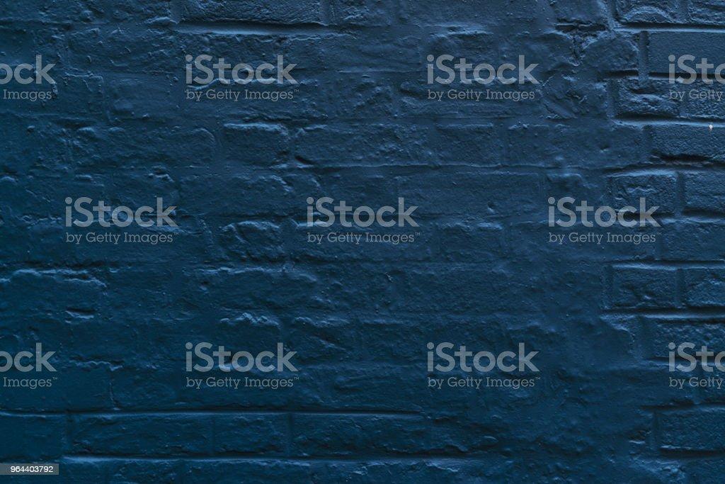 Navy blue brick wall background stock photo
