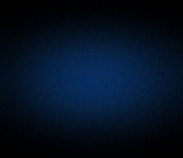 A navy blue colored background stock photo