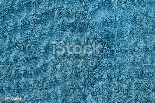 1128272390 istock photo Navy blue dark fabric texture background top view banner. Classic blue cloth empty canvas 1177120881