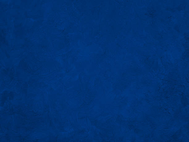 navy blue painted with brush strokes background. - dark blue stock pictures, royalty-free photos & images