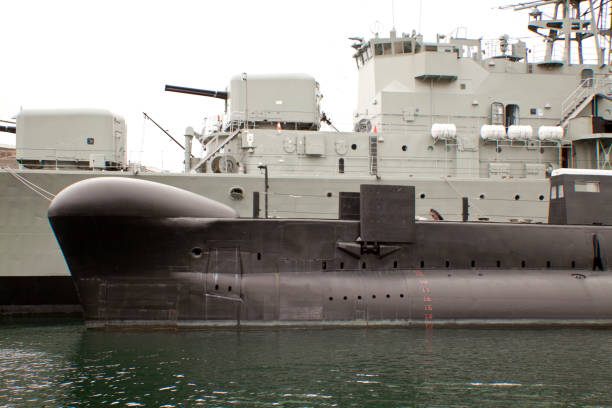 Navy frigat with submarin stock photo