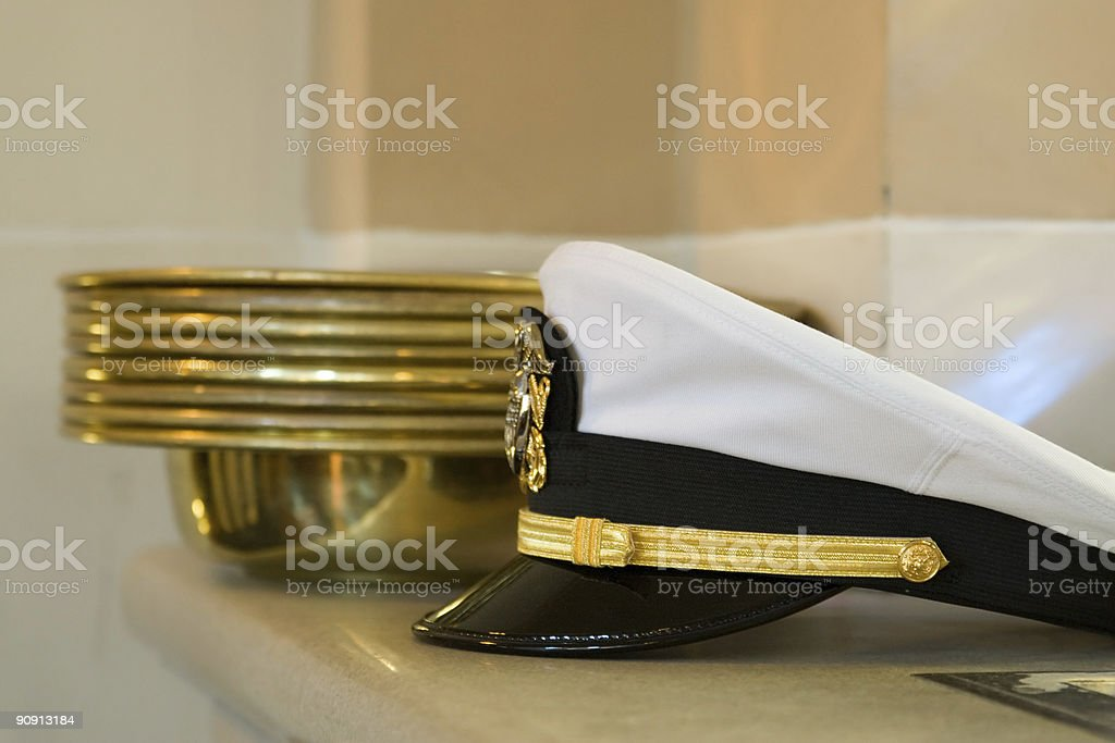 Navy hat and offering collection plates royalty-free stock photo