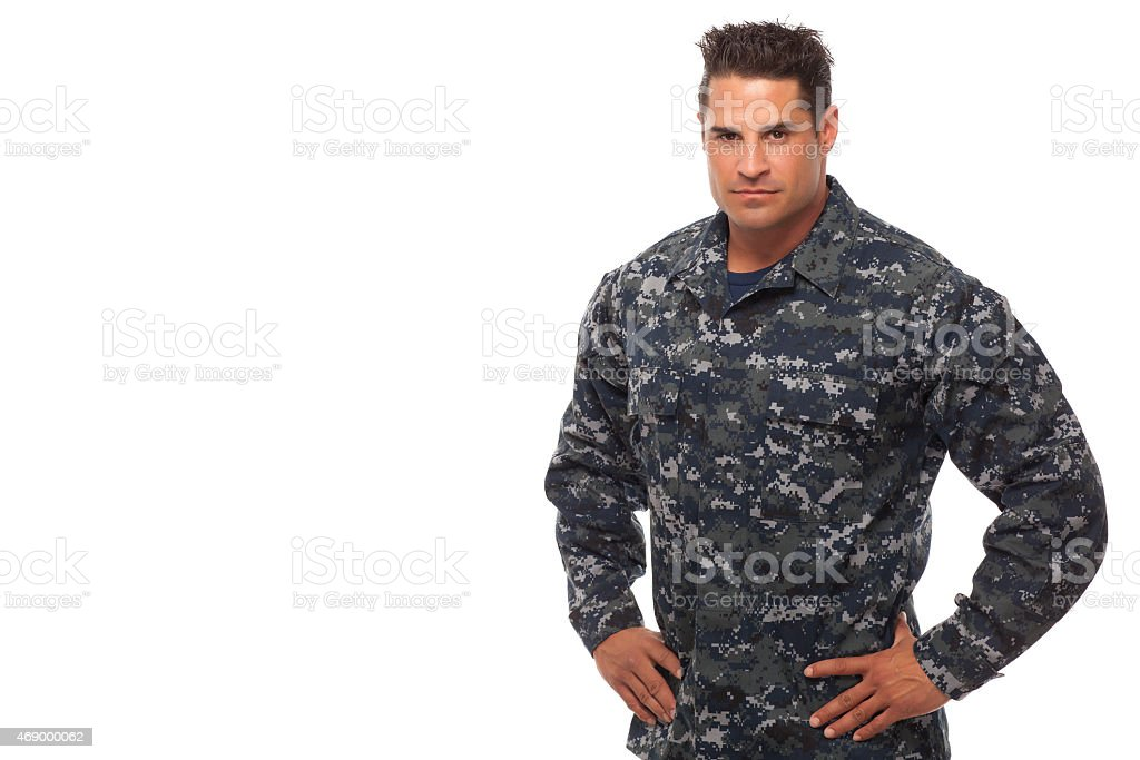Navy man with hands on hips stock photo