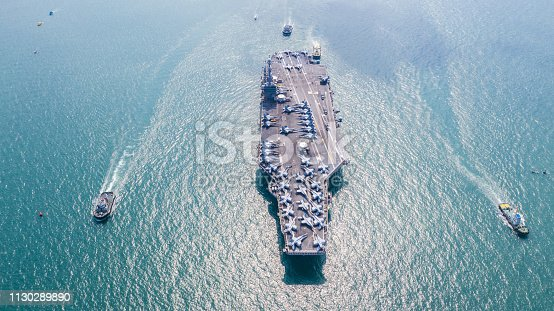 istock Navy Nuclear Aircraft carrier, Military navy ship carrier full loading fighter jet aircraft, Aerial view. 1130289890
