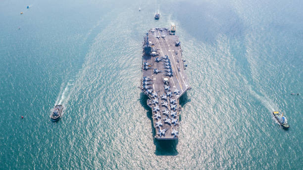 Navy Nuclear Aircraft carrier, Military navy ship carrier full loading fighter jet aircraft, Aerial view. Navy Nuclear Aircraft carrier, Military navy ship carrier full loading fighter jet aircraft, Aerial view. marines military stock pictures, royalty-free photos & images