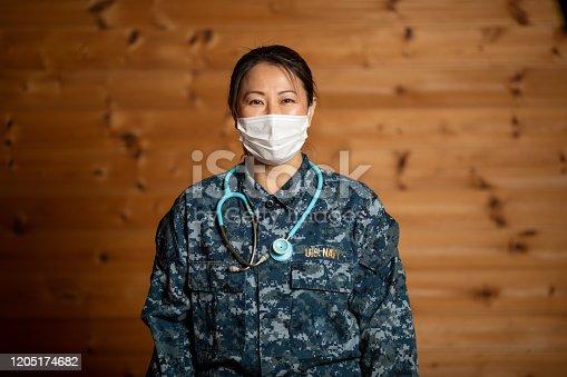 A nurse in US Navy uniform half length portrait.