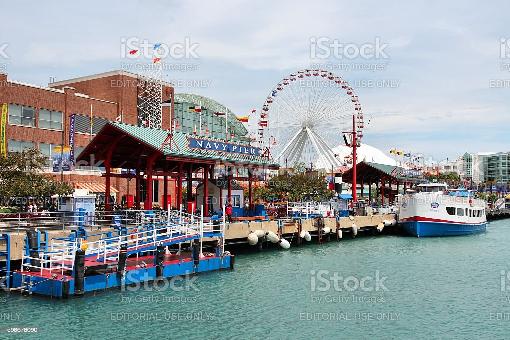 Navy Pier, Chicago Chicago, United States - June 26, 2013: People visit famous Navy Pier on June 26, 2013 in Chicago. The 3,300-foot pier built in 1916 is one of most recognized Chicago landmarks. Architecture Stock Photo