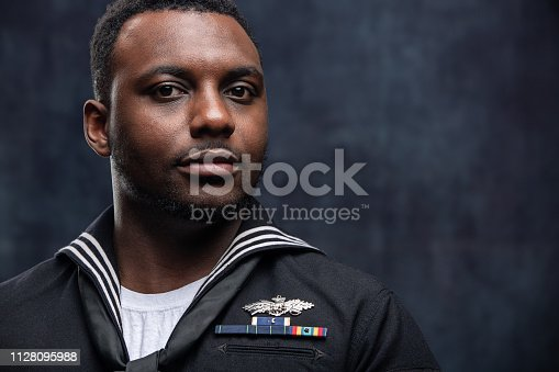 African American Service Man wearing the official US Navy Seabees uniform. The Seabees are the engineers of the US Navy and work closely with the US Marines. The model is an actual veteran.