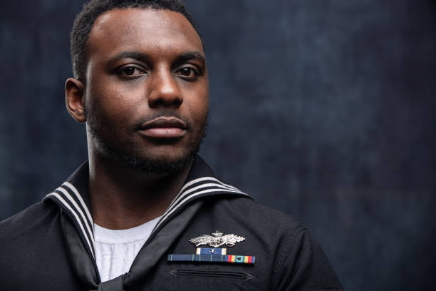US Navy Seabee Service Member African American Service Man wearing the official US Navy Seabees uniform. The Seabees are the engineers of the US Navy and work closely with the US Marines. The model is an actual veteran. sailor stock pictures, royalty-free photos & images