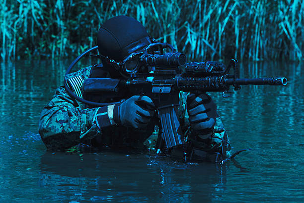 Navy SEAL frogman Navy SEAL frogman with complete diving gear and weapons in the water mount combatant stock pictures, royalty-free photos & images