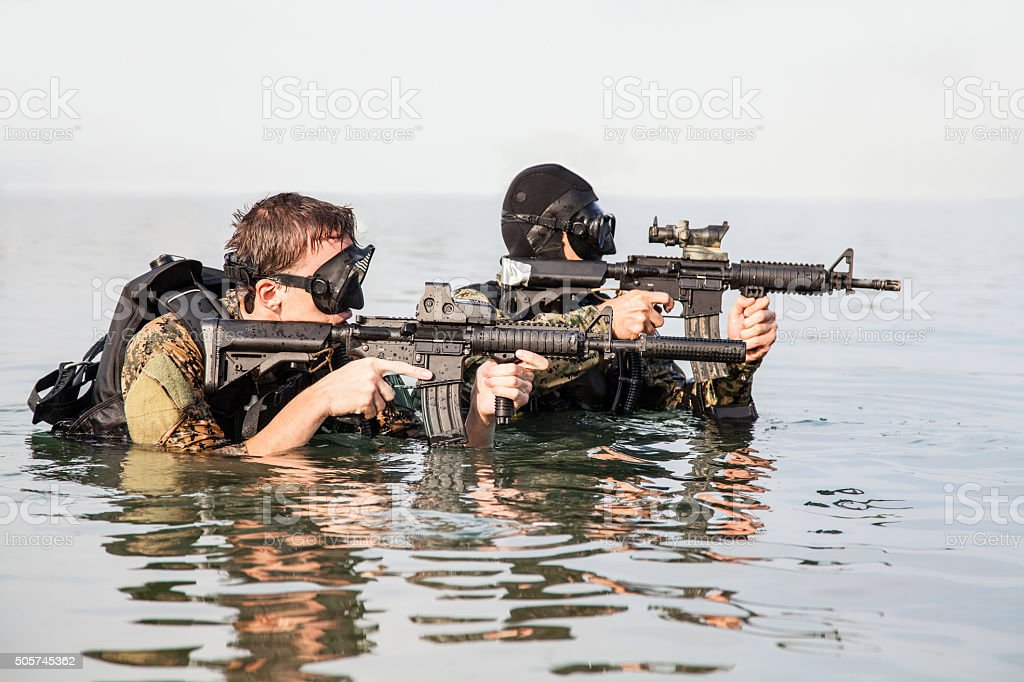 Navy SEAL frogmen stock photo