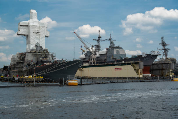 Navy Ships in Dock for Repair Norfolk, VA, USA -- June 6, 2019. Navy ships are berthed in Norfolk, VA for maintenance and repair. naval base stock pictures, royalty-free photos & images