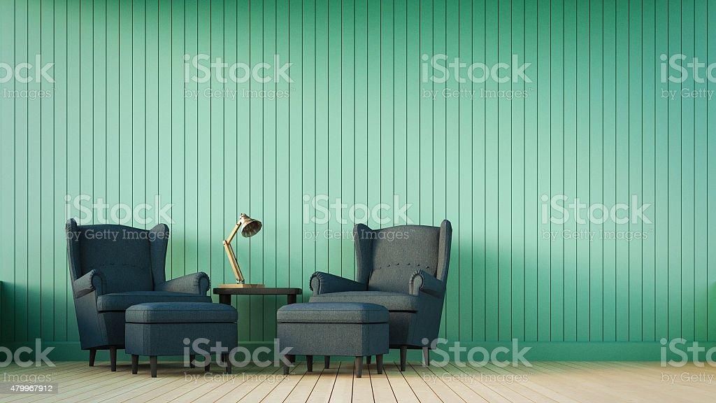 Divano blu navy e verde parete con righe verticali foto di stock