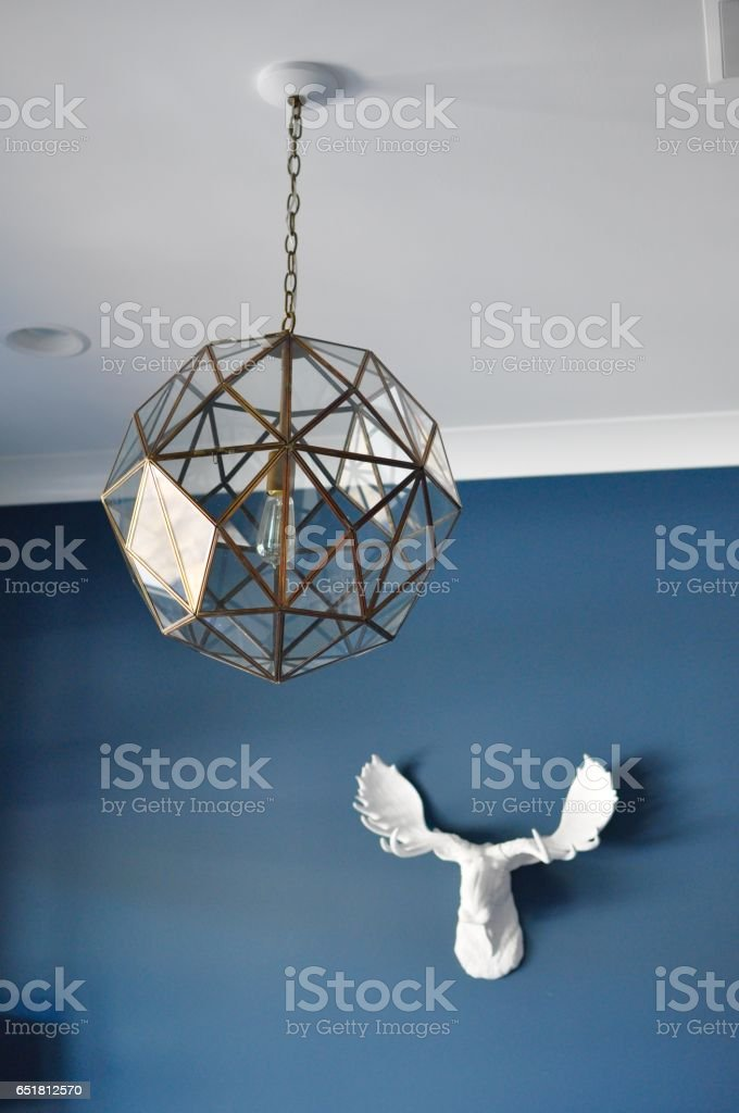 Navy wall with light and white moose head stock photo