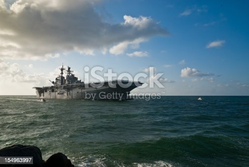 Morning sun illuminates the USS Iwo Jima (LHD-7) as she sails into Port Everglades in Fort Lauderdale, Fl..  This is a