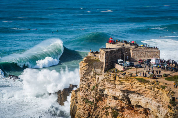 Nazare, Portugal, Huge Waves Breaking Near the Fort of Sao Miguel Arcanjo Lighthouse stock photo