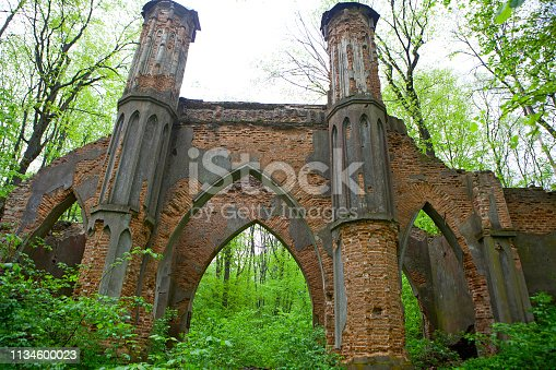 ncient gothic stone wall with arches and columns