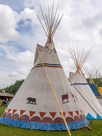 Entrance to the Indian village with tepees and totems.