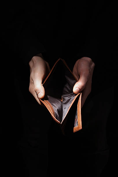 Nead another loan Man hands presenting his empty wallet empty wallet stock pictures, royalty-free photos & images