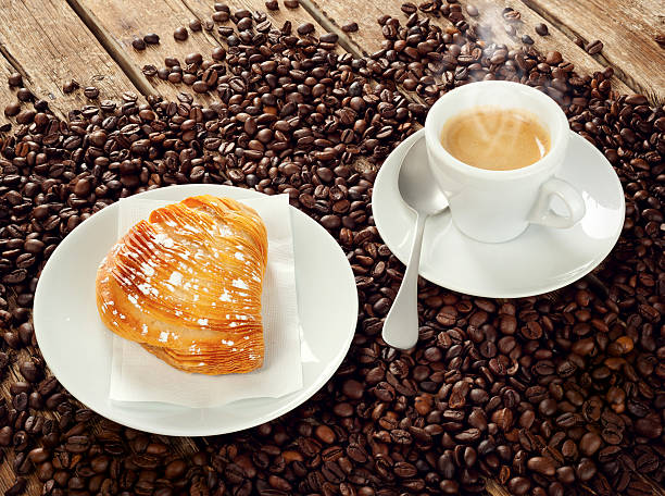 Neapolitan Sfogliatella riccia with espresso Neapolitan Sfogliatella riccia with cup of espresso coffee red delicious apple stock pictures, royalty-free photos & images