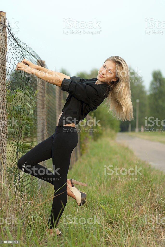 Near the fence royalty-free stock photo