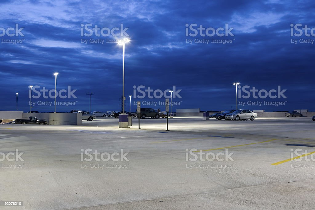 Nearly Empty Concrete Parking Lot At Dusk stock photo