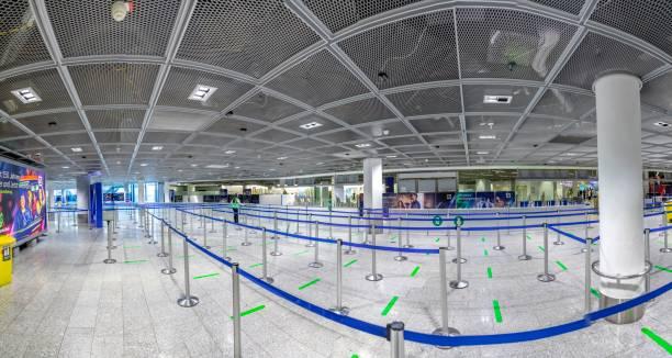 nearly empty Terminal 1 during the Coronavirus Corona Virus COVID-19 at Frankfurt airport (FRA) in Germany. stock photo