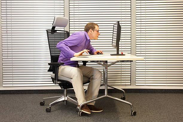 near-sightedness, myopia. office worker at work station - kopfstütze stock-fotos und bilder