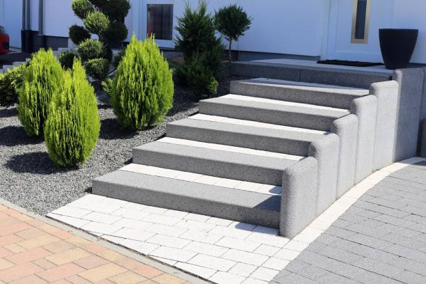 Neat and tidy front yard with solid block steps, decorative gravel and planting stock photo