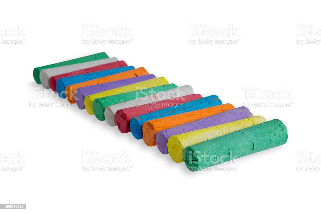 Neat diagonal row of colored chalks photo libre de droits