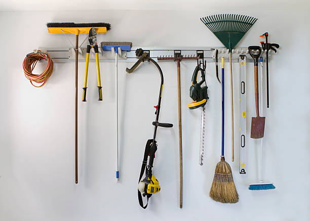 Neat garage tool hanging storage Neat garage tools hanging on a storage rack broom stock pictures, royalty-free photos & images