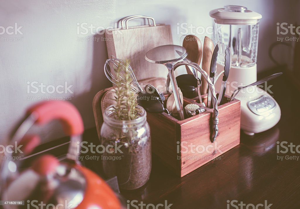 Neat kitchen counter with collection of cooking utensils stock photo
