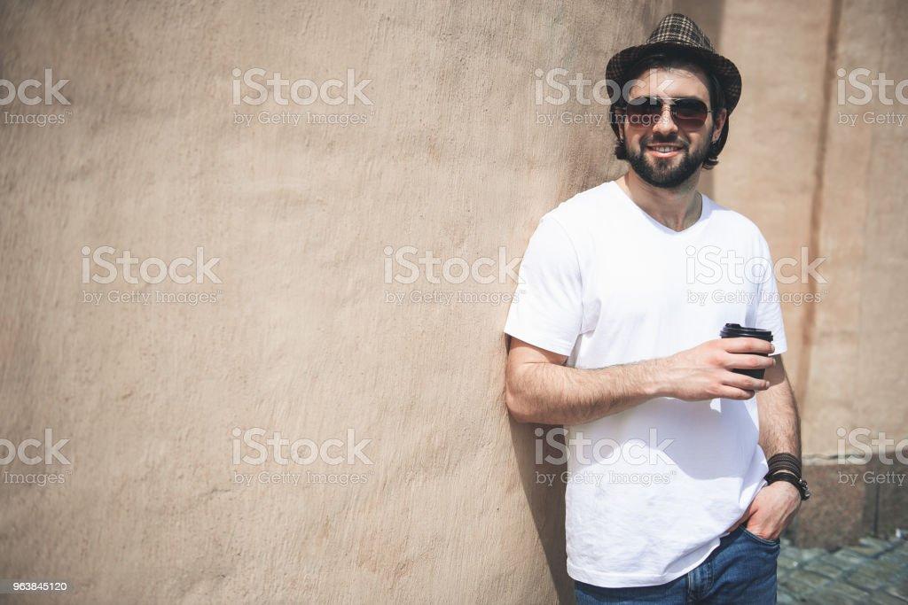 Neat man taking coffee break on walk - Royalty-free Adult Stock Photo