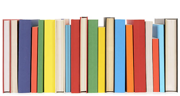 Neat row of colorful paperback books stock photo