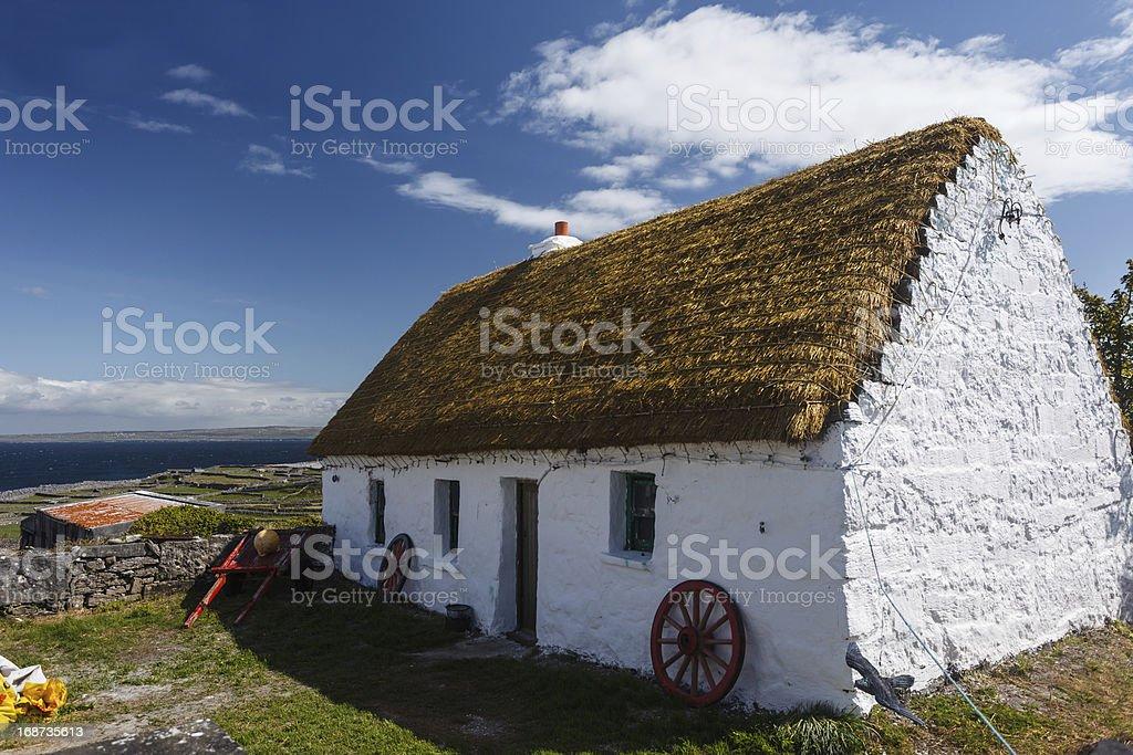 Neat whitewashed Irish cottage on the island of Inishee stock photo