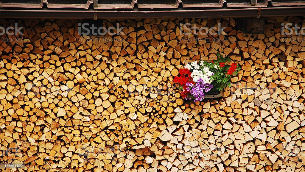 Neat Wood Stack with Flowers royalty-free stock photo