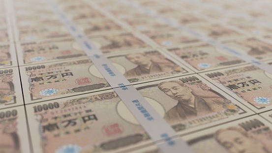 A neatly aligned Japanese wad of 10,000 yen bills