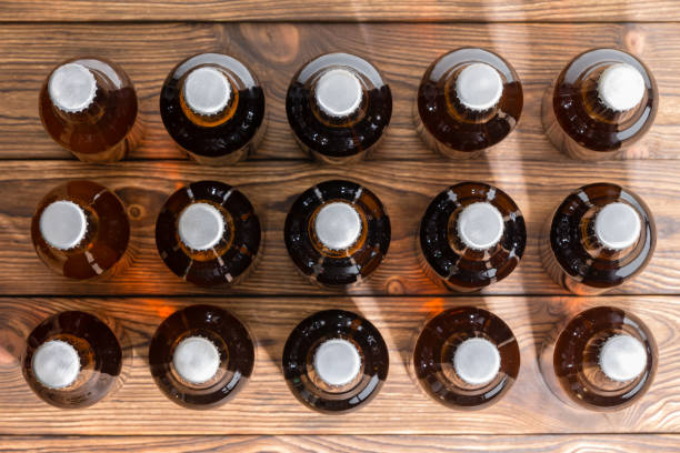 Neatly aligned rows of bottled craft beer stock photo