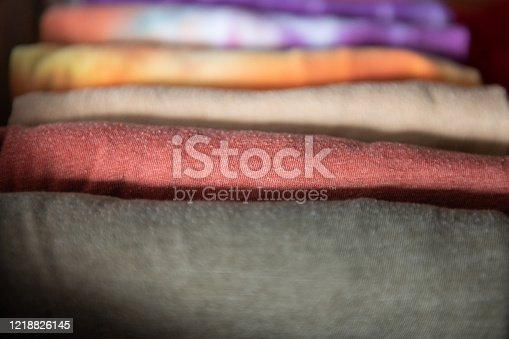 1164403364 istock photo Neatly Folded Organized T-Shirts in an Dresser Drawer at Home 1218826145