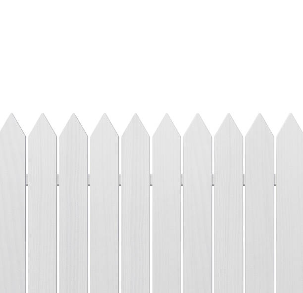 neatly painted and lined white wooden fence - fence stock photos and pictures