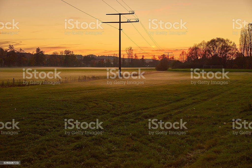 Nebel über den Wiesen bei Sonnenuntergang stock photo